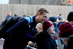 Burnley's new signing Peter Crouch poses for a photograph as he makes his way into the ground before the Premier League game between Burnley and Southampton.
