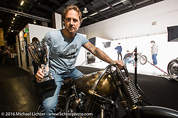 Stefano Martinelli of Punto Di Fuga PDF Motociclette in Bergamo, Italy with his trophy and winning bike after the awards at the AMD World Championship of Custom Bike Building in the custom dedicated Hall 10 at the Intermot Motorcycle Trade Fair. Cologne, Germany. Sunday October 9, 2016. Photography ©2016 Michael Lichter.