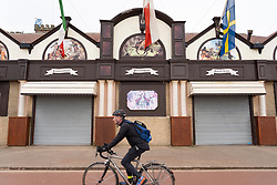 Portobello, Edinburgh, Scotland, UK. 5 April, 2020.  Images of Portobello promenade on the second Sunday of the coronavirus lockdown in the UK. Cyclist rides past closed amusement arcade.