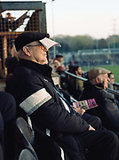 A Dulwich Hamlet fan uses a programme as a sun shade during the Oxford City game on the 11th November 2018 at the KNK Stadium in South London in the United Kingdom. The KNK Stadium is Dulwich Hamlets temporary ground following eviction from their home ground, Champion Hill in March 2018.
