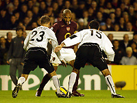 Photo: Chris Ratcliffe.<br />Arsenal v Sparta Prague. UEFA Champions League.<br />02/11/2005.<br />Thierry Henry (C) tries to get past Prague's Michal Kadlec and Petr Lucas