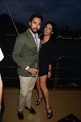 The Johnnie Walker Gold Label Reserve Party aboard John Walker & Sons Voyager, St.Georges Stairs Tier, Butler's Wharf Pier, London, UK on 17th July 2013.<br /> Picture Shows:-DIEGO BIVERO-VOLPE & Amy Molyneaux