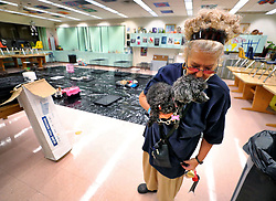 Paula Peterson of Casselberry, Fla., hugs her dog 'Little Lola' while waiting out the weather spawned by Hurricane Dorian, Tuesday, September 3, 2019, at a storm shelter set up at Lyman High School, in Longwood, near Orlando. Photo by Joe Burbank/Orlando Sentinel/TNS/ABACAPRESS.COM