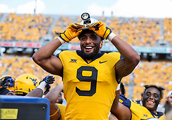 Oct 6, 2018; Morgantown, WV, USA; West Virginia Mountaineers safety Jovanni Stewart (9) celebrates a turnover along the sidelines during the fourth quarter against the Kansas Jayhawks at Mountaineer Field at Milan Puskar Stadium. Mandatory Credit: Ben Queen-USA TODAY Sports