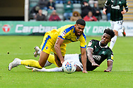 Jake Jervis (10) of AFC Wimbledon is fouled by Ashley Smith-Brown (23) of Plymouth Argyle during the EFL Sky Bet League 1 match between Plymouth Argyle and AFC Wimbledon at Home Park, Plymouth, England on 6 October 2018.