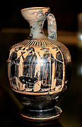 Black- figured Lakythos (oil or perfume bottle): a group of men, two with spears, and a deer Made in Athens about 540-520 From Athens.