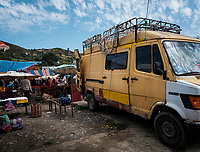 FEZ, MOROCCO - CIRCA MAY 2018:  Old van used by merchants on a typical market in the outskirts of Fez in Morocco