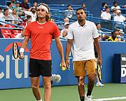 STEFANOS TSISPAS and NICK KYRGIOS  play doubles at the Rock Creek Tennis Center.