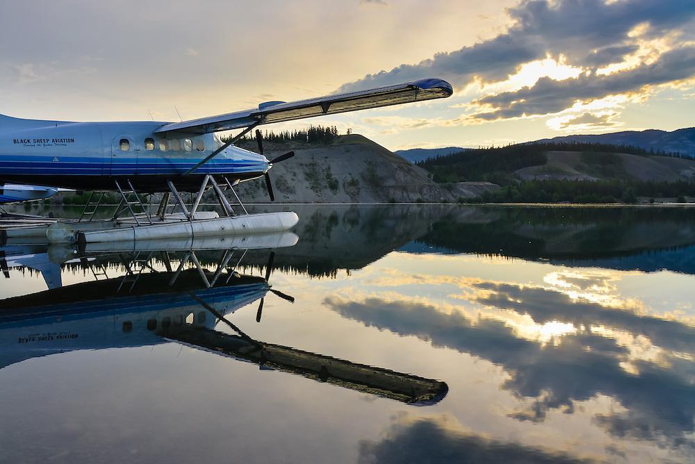 Early morning sunrise and Turbo Otter reflections at Schwatka Lake, Yukon