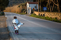 LESVOS, GREECE - FEBRUARY 09: A young girl covered by a thermal blanket runs on a road after her arrival to a beach in South Lesvos with other refugees and migrants from the Turkish coast on February 09, 2015 in Lesvos, Greece. Photo: © Omar Havana. All Rights Are Reserved
