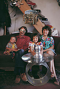 Tony Price (1937-2000), here with his family, created sculptures from scrap metal bought at the salvage yard at the Los Alamos National Lab and built sculptures which convey anti-nuclear themes and messages. Santa Fe, New Mexico MODEL RELEASED (1988)