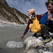 Pete McBride performs a Ganga Puja with a sannyasi - or renouncer - on the banks of the Bhagirathi (Ganges) River at Chirbhasa, Garhwal Himalaya, Uttarkhand, India.