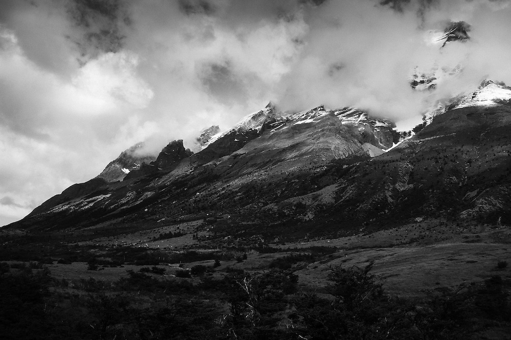Cloud-wrapped peaks in the Torres del Paine national park, Patagonia, Chile.