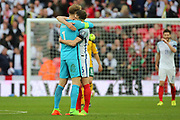 Joe Hart of England hugging John Stones of England during the FIFA World Cup Qualifier group stage match between England and Lithuania at Wembley Stadium, London, England on 26 March 2017. Photo by Matthew Redman.