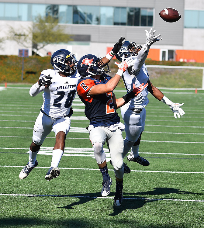 Orange Coast Pirate wide receiver Joey Cox (2) attempts to haul in a pass during football action between Orange Coast College vs Fullerton College.<br /> <br /> @2016 Rick May Photography / Sports Shooter Academy - Rick May Photography