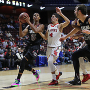 PJ Dozier, South Carolina, drives to the basket past Federico Mussini, St. John's, during the St. John's vs South Carolina Men's College Basketball game in the Hall of Fame Shootout Tournament at Mohegan Sun Arena, Uncasville, Connecticut, USA. 22nd December 2015. Photo Tim Clayton