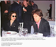 Bianca Jagger & Mick Jagger sitting together at a dinner in honour of David Tang. Larry Gagosian Gallery. North Cam[pden Drive. Beverly Hills. Beverly Hills.Los Angeles. 22 March 1997. Film.97118/23<br />© Copyright Photograph by Dafydd Jones<br />66 Stockwell Park Rd. London SW9 0DA<br />Tel 0171 733 0108