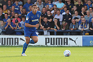 AFC Wimbledon defender Rod McDonald (26) dribbling during the EFL Sky Bet League 1 match between AFC Wimbledon and Portsmouth at the Cherry Red Records Stadium, Kingston, England on 13 October 2018.