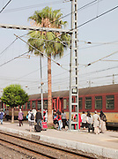 People moving along the platform to board a train at the modern station in the Ville Nouvelle, the new town, in Fes, Morocco