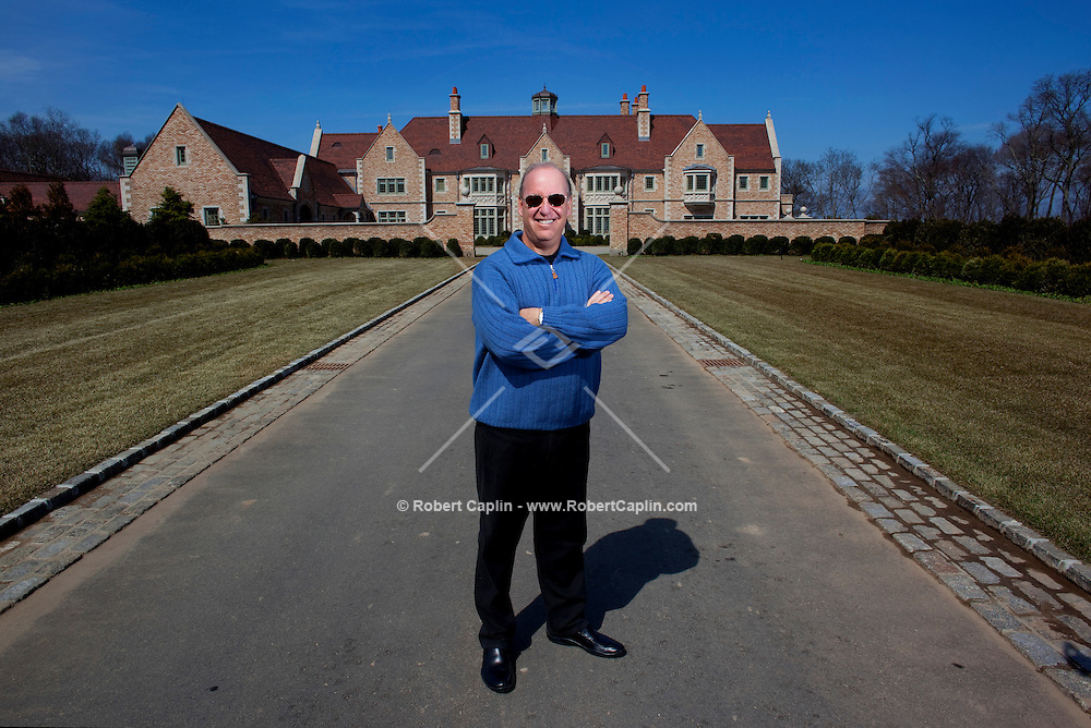 Steven Schonfeld stands outside his newly built $90 million home in Long Island, NY on Thursday, March 26, 2009.