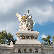 A monument to former Mexican president Benito Juárez, who served in the office five times in the 19th century and was widely credited with resisting French incursions and moderning Mexico. The monument sits in Alameda Central (central mall) in the Centro Historico district of Mexico City, Mexico. The main statue, by Italian sculptur  Lazzaroni, shows Juárez seated. On either side are symbolic figures depicting the crowning motherland, justice with a glory torch, and a couple of lions on the seat of the pedestal over which these pieces are placed.