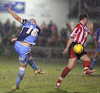 Photo: Pete Lorence.<br />Lincoln City v Wycombe Wanderers. Coca Cola League 2. 30/12/2006.<br />Tommy Mooney's shot catches a nasty deflection off Lee Beevers.