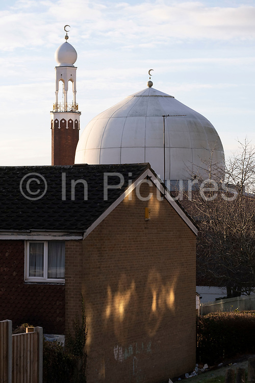 Birmingham Central Mosque minaret tower in Highgate on 7th January 2021 in Birmingham, United Kingdom. Birmingham Central Mosque is one of the earliest purpose-built mosques in the UK, and is run by the Birmingham Mosque Trust. The organization, Muslims in Britain classify the Birmingham Central Mosque as, hanafi sunni, and has a capacity of 6,000, including women.