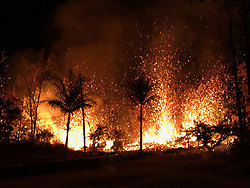 May 5, 2018 - Hawaii, U.S. - A new fissure erupted this evening near fissures 2 and 7, beginning with small lava spattering at about 8:44 p.m. HST. By 9:00 p.m., lava fountains as high as about 70 m (230 ft) were erupting from the fissure. Homes destroyed by Hawaii's Kilauea volcano has climbed to at least 30. Lava has been spewing more than 200 feet in the air. More than 1,700 people evacuated (Credit Image: © USGS/ZUMA Wire/ZUMAPRESS.com)