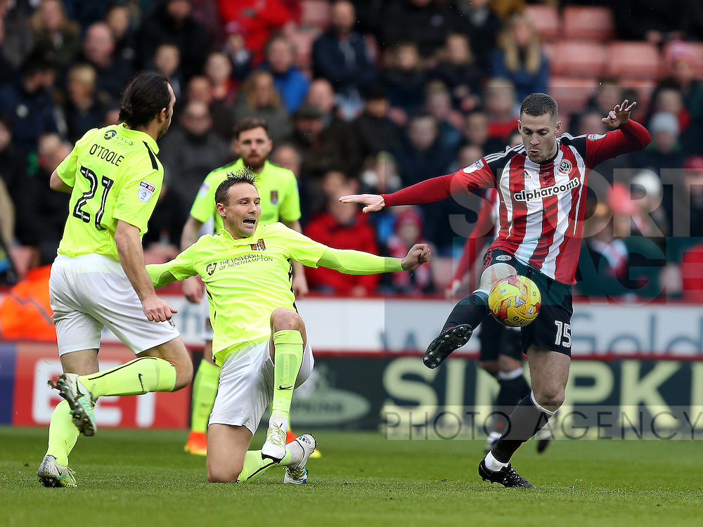 Paul Coutts of Sheffield Utd and Matthew Taylor of Northampton during the English League One match at Bramall Lane Stadium, Sheffield. Picture date: December 31st, 2016. Pic Simon Bellis/Sportimage