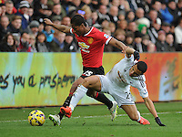 Manchester United's Luis Antonio Valencia vies for possession with Swansea City's Jefferson Montero<br /> <br /> Photographer Ashley Crowden/CameraSport<br /> <br /> Football - Barclays Premiership - Swansea City v Manchester United - Saturday 21st February 2015 - Liberty Stadium - Swansea<br /> <br /> © CameraSport - 43 Linden Ave. Countesthorpe. Leicester. England. LE8 5PG - Tel: +44 (0) 116 277 4147 - admin@camerasport.com - www.camerasport.com