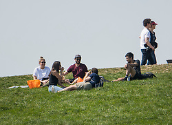 © Licensed to London News Pictures. 11/04/2020. London, UK. People sunbathing and gathering on Primrose Hill, London over Easter Bank holiday weekend, during a pandemic outbreak of the Coronavirus COVID-19 disease. The public have been told they can only leave their homes when absolutely essential, in an attempt to fight the spread of coronavirus COVID-19 disease. Photo credit: Ben Cawthra/LNP