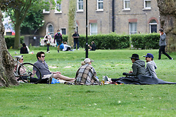 © Licensed to London News Pictures. 10/05/2020. London, UK. Members of public in London Fields park in Hackney, north London today, following a tweet from local police reporting that hundreds of people were having pizzas, beers and wine on the hottest day of the year so far during lockdown on Saturday 9 May. Later today, Prime Minister Boris Johnson is set to announce measures to ease the coronavirus lockdown, which was introduced on 23 March to slow the spread of the COVID-19. Photo credit: Dinendra Haria/LNP