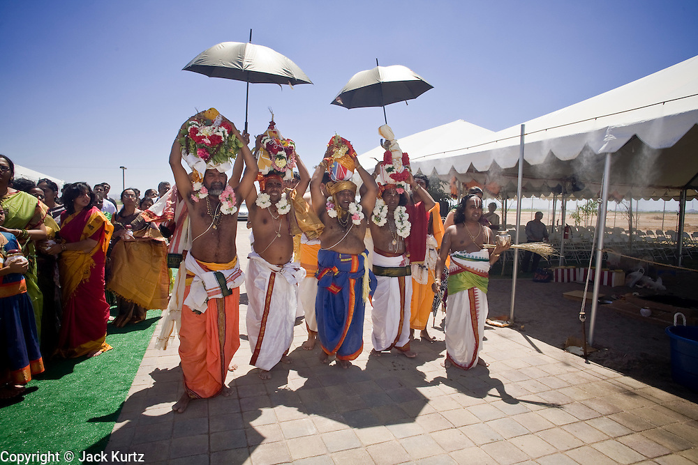18 MAY 2008 -- MARICOPA, AZ: Hindu holy men process around the new Hindu temple in Maricopa, AZ, during dedication of the temple Sunday. More than 3,000 Hindus from Arizona, southern California and New Mexico came to Maricopa, a small town in the desert about 50 miles south of Phoenix, for the dedication of the Maha Ganapati Temple of Arizona. It is the first Hindu temple in Arizona designed according to ancient South Indian Hindu architectural guides. Craftsmen from India came to Maricopa to complete the interior details of the temple. The dedication ceremonies lasted three days.   Photo by Jack Kurtz / ZUMA Press