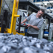 Mature man working in factory