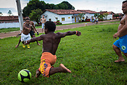 "The ""Giants of the North"" football team improvise a game of football amongst themselves in Ponto Franco, Maranhao. The team was formed and was the brain child of Capacidade a fellow dwarf. Wherever they travel they always attract much attention and are viewed with affection and respect."