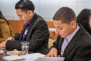 Purchase, NY – 31 October 2014. Lincoln High School team member Edimaobong Umana, right) checks his case study notes. The Business Skills Olympics was founded by the African American Men of Westchester, is sponsored and facilitated by Morgan Stanley, and is open to high school teams in Westchester County.