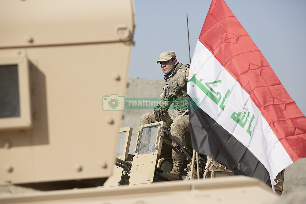 November 11, 2016 - Mosul, Nineveh, Iraq - A soldier, belonging to the Iraqi Army's 9th Armoured Division, sits on the turret of an armoured Humvee as his unit visits Mosul's Al Inisar district on the south east of the city. The Al Intisar district was taken four days ago by Iraqi Security Forces (ISF) and, despite its proximity to ongoing fighting between ISF and ISIS militants, many residents still live in the settlement without regular power and water and with dwindling food supplies. (Credit Image: © Matt Cetti-Roberts via ZUMA Wire)