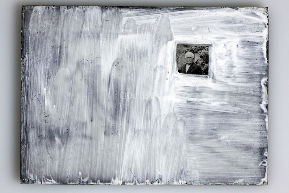 glass plate image covered with white paint except for one face