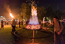 """© Licensed to London News Pictures. 01/09/2016. London, UK. """"Fire Garden"""", comprising burning metal structures, cascading candles and flickering flowerpots, by one of France's most prominent street art groups, Compagnie Carabosse, transforms the front lawn of Tate Modern.  The artwork is part of Great Fire 350, a commemoration of the 350th anniversary of the Great Fire of London, taking place in the capital 1 to 4 September. Photo credit : Stephen Chung/LNP"""