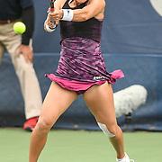 LAUREN DAVIS hits a backhand at the Rock Creek Tennis Center.