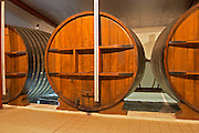 A storage room in the winery with old wooden foudres (large wooden barrels) Chateau Thieuley La Sauve Majeure Entre-deux-Mers Bordeaux Gironde Aquitaine France