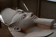 Ramses II colossal statue, carved in limestone, in Memphis open air museum
