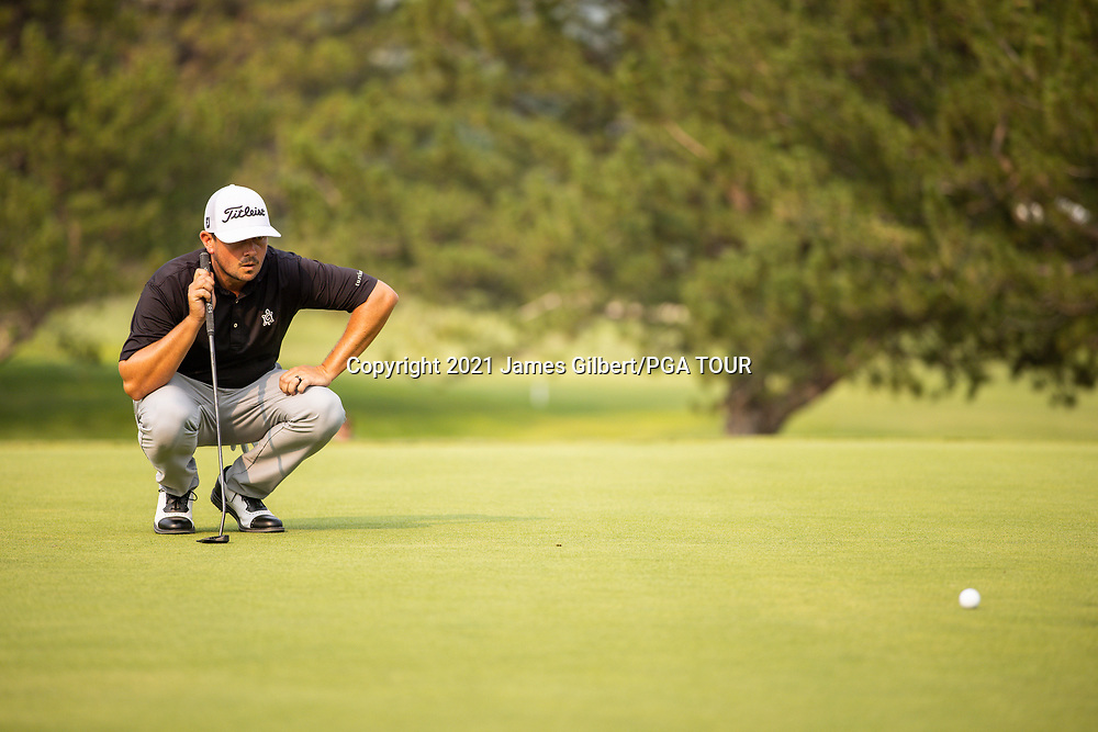 FARMINGTON, UT - AUGUST 08: Joshua Creel lines up his putt on the 18th green during the final round of the Utah Championship presented by Zions Bank at Oakridge Country Club on August 8, 2021 in Farmington, Utah. (Photo by James Gilbert/PGA TOUR via Getty Images)