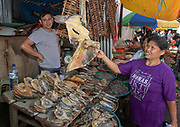 Selling fish at Tomohon extreme market, north Sulawesi, Indonesia.