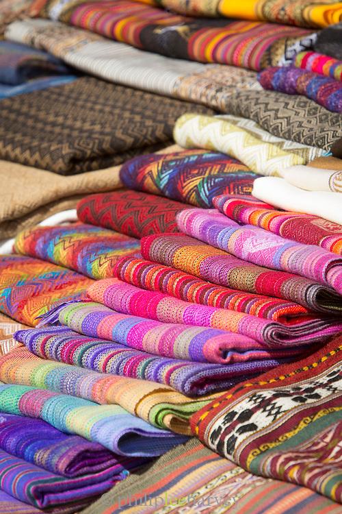 An arrangement of handmade textiles for sale at Chinchero Town Sunday Market, Cusco Region, Peru, South America