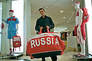 Moscow, Russia, 17/06/2006..A member of the sports department staff in the Bosco di Ciliegi city centre fashion store. Bosco di Ciliegi  supply the Russian Olympic team with their costumes.