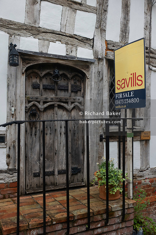 A medieval house is on sale by the Savills estate agent, on 9th July 2020, in wool town Lavenham, Suffolk, England. By the late 15th century, the town was among the richest in the British Isles, paying more in taxation than considerably larger towns such as York and Lincoln. Several merchant families emerged, the most successful of which was the Spring family. Lavenham became a prosperous town based on cloth making. The wool trade was already present by the 13th century, steadily expanding as demand grew. By the 1470s Suffolk produced more cloth than any other county.