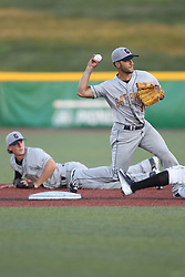 24 July 2015:  Rolando Gomez gets the flip from Seth Heck to put out Aaron Wright before firing to 1st base for a double play attempt during a Frontier League Baseball game between the Gateway Grizzlies and the Normal CornBelters at Corn Crib Stadium on the campus of Heartland Community College in Normal Illinois
