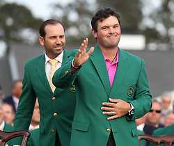 April 8, 2018 - Augusta, Georgia, U.S. - SERGIO GARCIA, left, presented PATRICK REED the green jacket after Reed won the Masters at Augusta National Golf Club on Sunday. (Credit Image: © Jason Getz/TNS via ZUMA Wire)