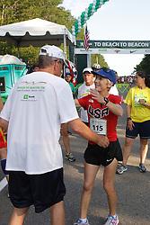 Joan Samuelson, Beach to Beacon 10K race founder , Joan Benoit Samuelson , greets Leon Gorman, Chairman of LL Bean